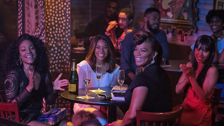 "Tiffany Haddish, Regina Hall, Queen Latifah, e Jada Pinkett Smith em ""Viagem de Meninas"" (2017) © Universal Pictures"